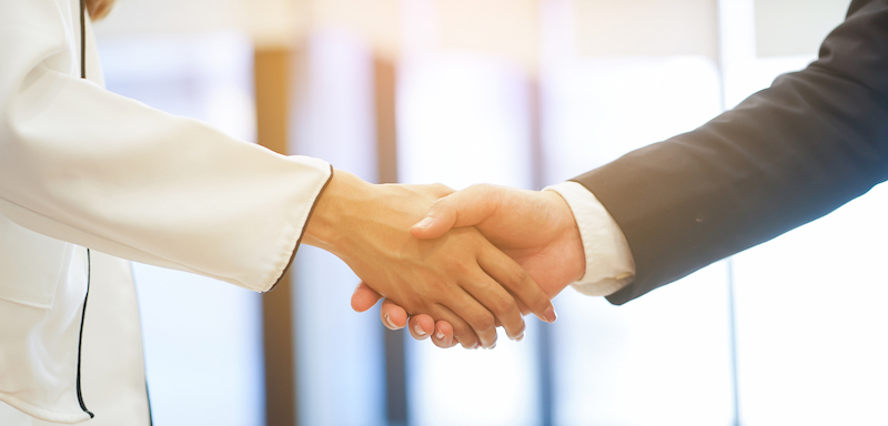 close up  politeness of businesswoman handshake with businessman partner vendor,collaboration of ceo leader hand shake for agreement or deal financial cooperative concept.